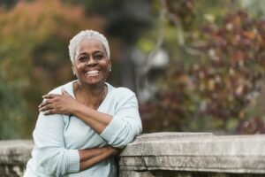 Woman smiling after menopause because of quality women's health care from HerKare