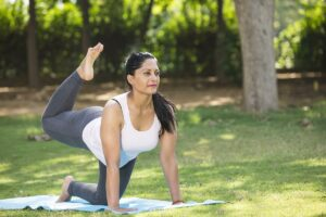 Woman doing yoga after Progesterone Replacement Therapy reduced hot flash symptoms